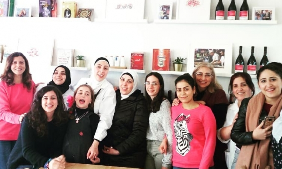 A group of Syrian refugees, who work at a Lisbon restaurant