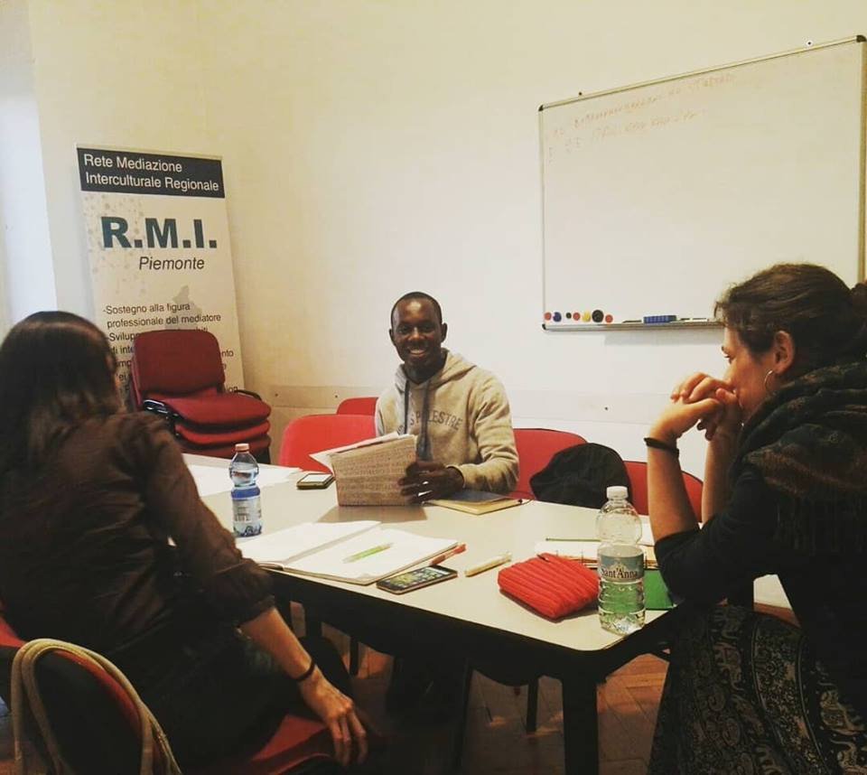 Bambara, a refugee from Mali, teaches at SPEAK in Turin.
